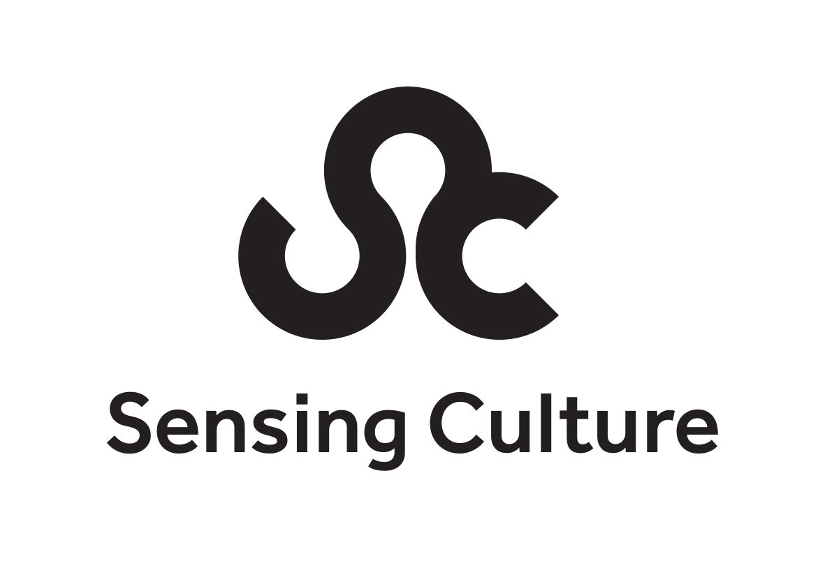 "Accessible logo with the words ""Sensing Culture"" in bold, black lettering. Above these words are the interlocked letters ""S"" and ""C"", also in bold, black lettering"